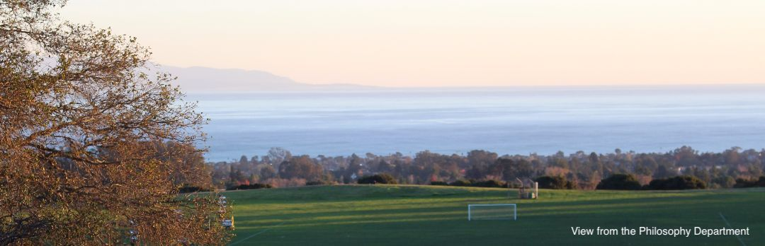 A view of Monterey Bay from Cowell College. Students play volleyball in the foreground.