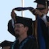 Benjamin Roome being hooded at graduate commencement